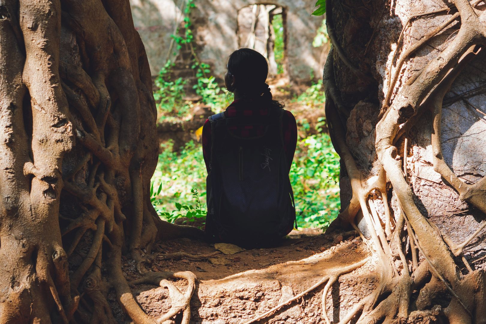 Woman Sitting on Roots
